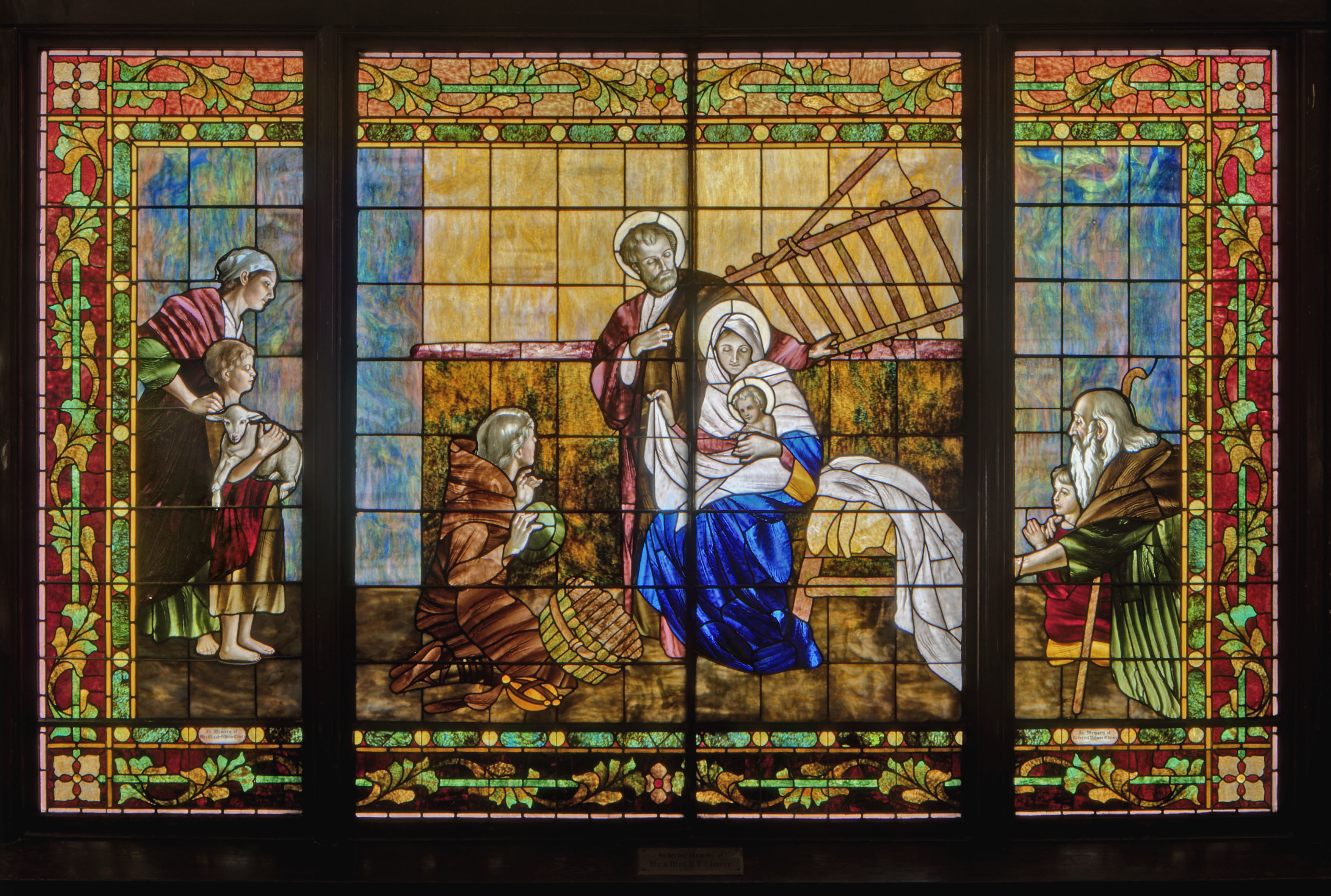 A image of a stained glass window inside the church.